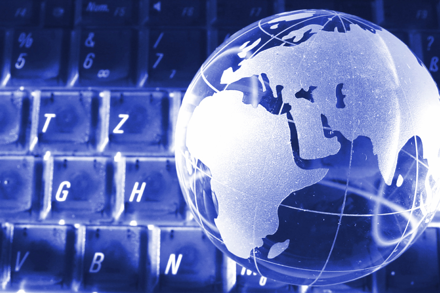 Image: Computer keyboard with globe in the background