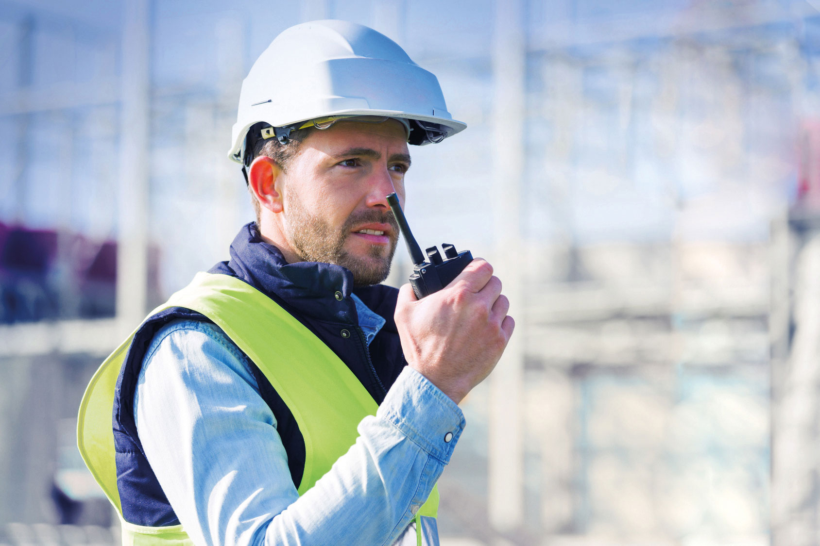 Image: CONET UC Radio Suite for Utilities - Worker with handheld Radio